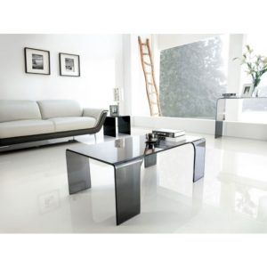 Large smoked glass coffee table on four legs